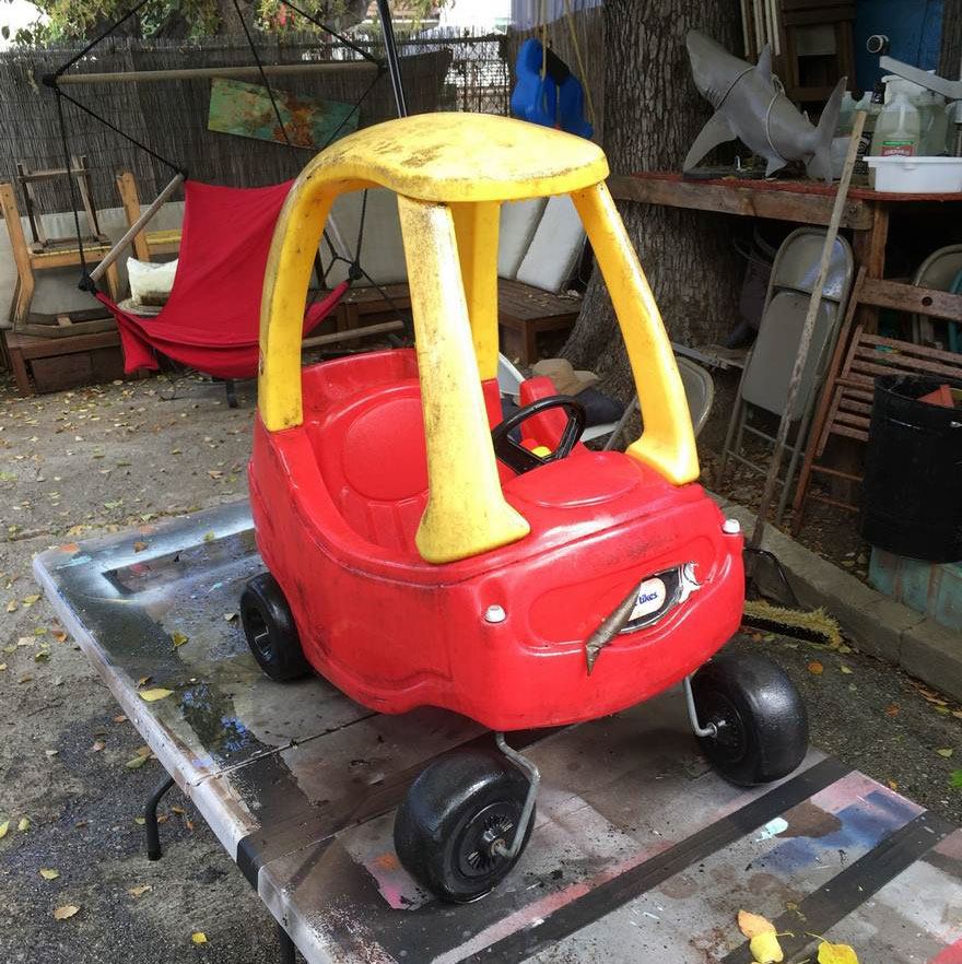 Dad, Ian Pfaff, takes step-by-step detailed photos while modifying the classic red and yellow Little Tykes car into a post-apocalyptic doom buggy