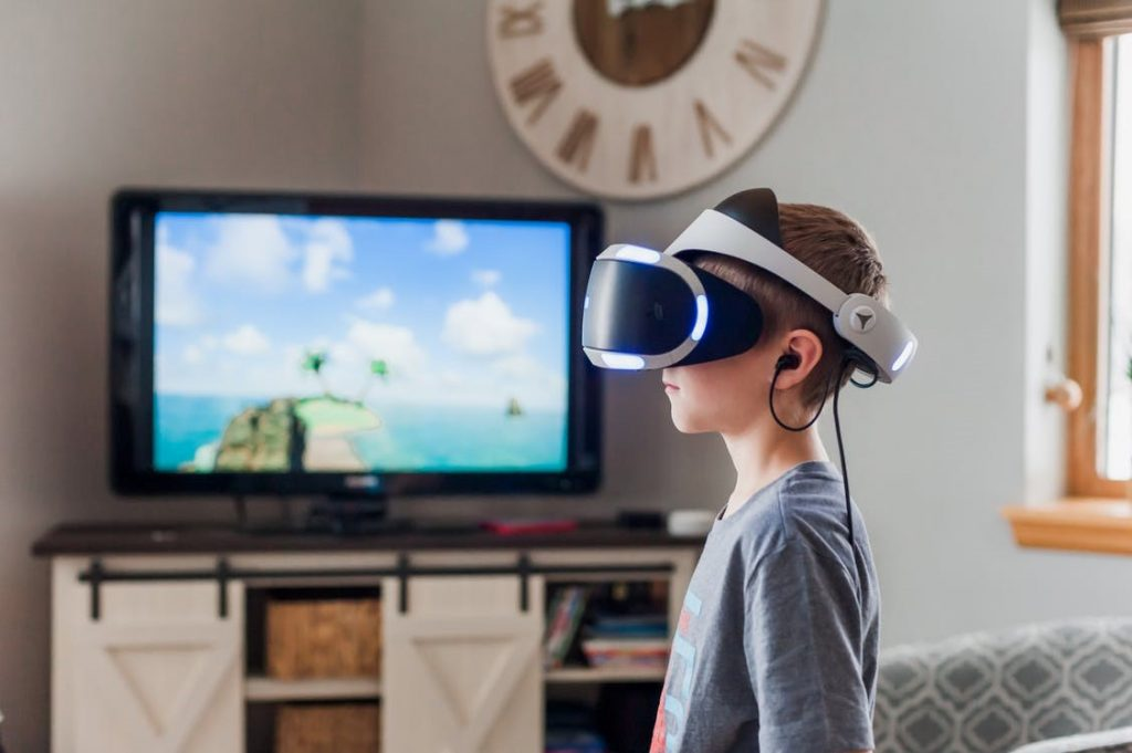Boy Wearing a Black and White Virtual Reality Goggles